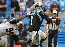 Dec 22, 2013; Charlotte, NC, USA; Carolina Panthers quarterback Cam Newton (1) is sacked by New Orleans Saints defensive end Cameron Jordan (94) in the second quarter at Bank of America Stadium. Mandatory Credit: Bob Donnan-USA TODAY Sports