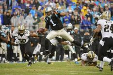 Dec 22, 2013; Charlotte, NC, USA; Carolina Panthers quarterback Cam Newton (1) runs as New Orleans Saints middle linebacker Curtis Lofton (50) and outside linebacker David Hawthorne (57) and cornerback Corey White (24) defend in the third quarter at Bank of America Stadium. Mandatory Credit: Bob Donnan-USA TODAY Sports