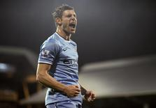 Manchester City's James Milner celebrates his goal against Fulham during their English Premier League soccer match at Craven Cottage in London December 21, 2013. REUTERS/Dylan Martinez