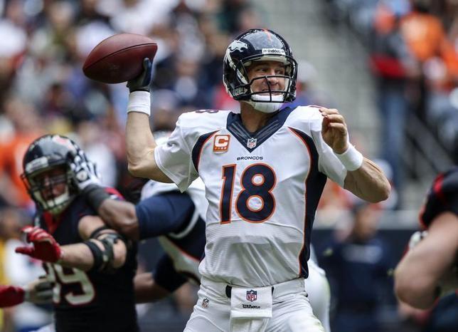 Dec 22, 2013; Houston, TX, USA; Denver Broncos quarterback Peyton Manning (18) attempts a pass during the second quarter against the Houston Texans at Reliant Stadium. Mandatory Credit: Troy Taormina-USA TODAY Sports - RTX16RRR