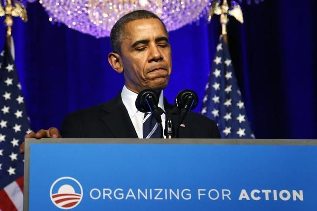 U.S. President Barack Obama pauses while delivering remarks on the Affordable Care Act, commonly known as Obamacare, at an Organizing for Action grassroots supporter event in Washington, November 4, 2013. REUTERS/Jonathan Ernst