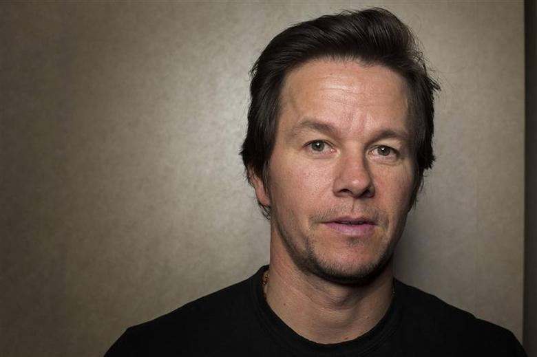 Actor Mark Wahlberg poses for a portrait while promoting the film ''Lone Survivor'' in New York, in this December 5, 2013, file photo. REUTERS/Lucas Jackson