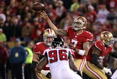 Dec 23, 2013; San Francisco, CA, USA; San Francisco 49ers quarterback Colin Kaepernick (7) passes the ball with pressure from Atlanta Falcons defensive end Jonathan Massaquoi (96) protected by San Francisco 49ers tackle Joe Staley (74) during the second quarter of the final regular season game at Candlestick Park. Mandatory Credit: Kelley L Cox-USA TODAY Sports