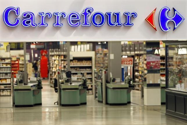 The logo of Carrefour is seen at the entrance of the Carrefour's Bercy hypermarket in Charenton Le Pont, near Paris, August 29, 2013. REUTERS/Charles Platiau