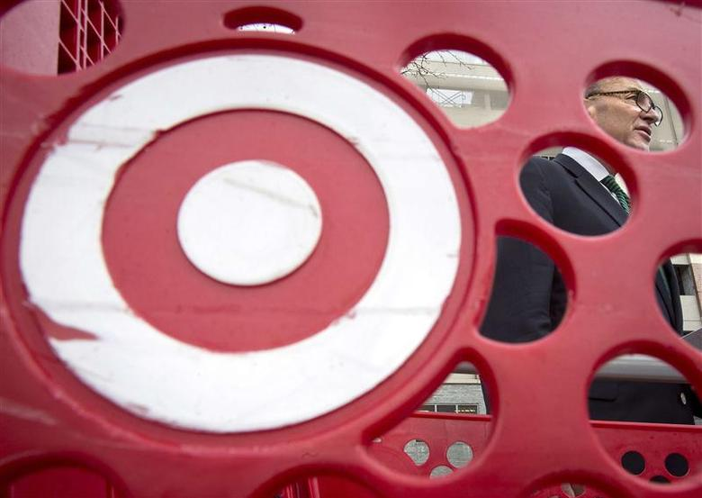 U.S. Senator Charles Schumer, is pictured through a Target shopping cart, as he holds a news conference about the massive credit card hack that has affected 40 million Target customers, in the Harlem area of New York December 22, 2013. REUTERS/Carlo Allegri