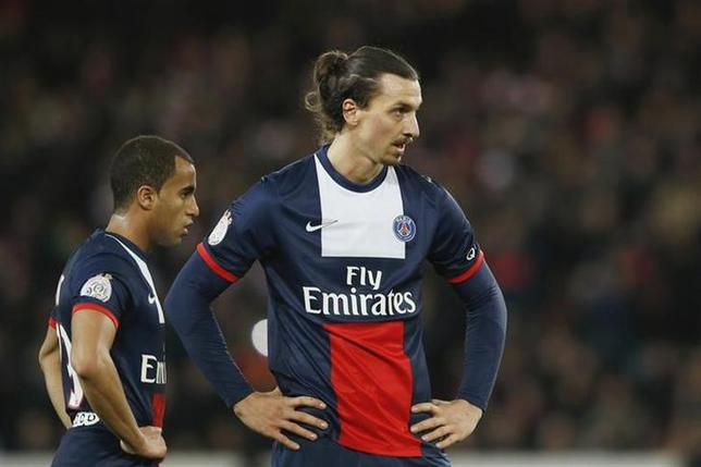 Paris St Germain's Zlatan Ibrahimovic (R) and Lucas react during their French Ligue 1 soccer match against Lille at the Parc des Princes Stadium in Paris December 22, 2013. REUTERS/Benoit Tessier