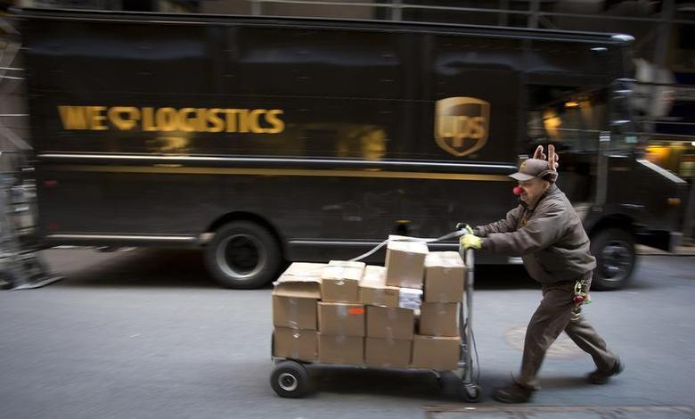 UPS delivery man Vinny Ambrosino prepares to deliver packages on Christmas Eve while wearing a Rudolf nose and antlers in New York, December 24, 2013. REUTERS/Carlo Allegri