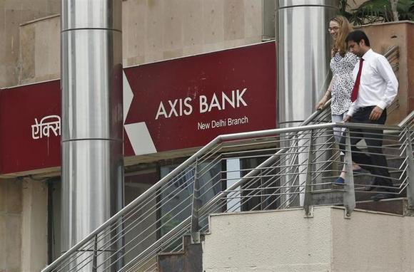 People use a staircase next to a corporate branch office of Axis Bank in New Delhi July 18, 2013. REUTERS/Anindito Mukherjee/Files