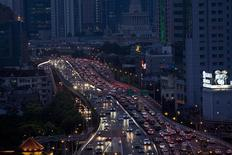 Lines of cars are pictured during a rush hour traffic jam in central Shanghai July 11, 2013. REUTERS/Aly Song