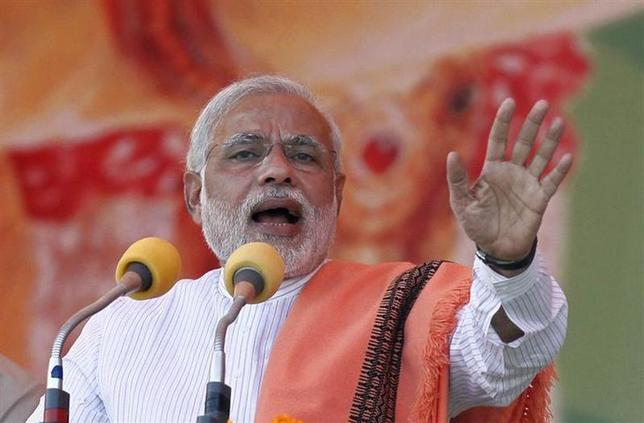 Hindu nationalist Narendra Modi, prime ministerial candidate for the main opposition Bharatiya Janata Party (BJP), addresses a rally in the northern Indian city of Agra November 21, 2013. REUTERS/Anindito Mukherjee/Files