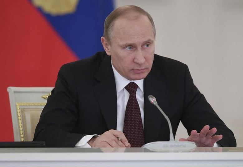 Russian President Vladimir Putin takes part in a meeting on social and economic development in Moscow's Kremlin December 23, 2013. REUTERS/Mikhail Metzel/RIA Novosti/Kremlin