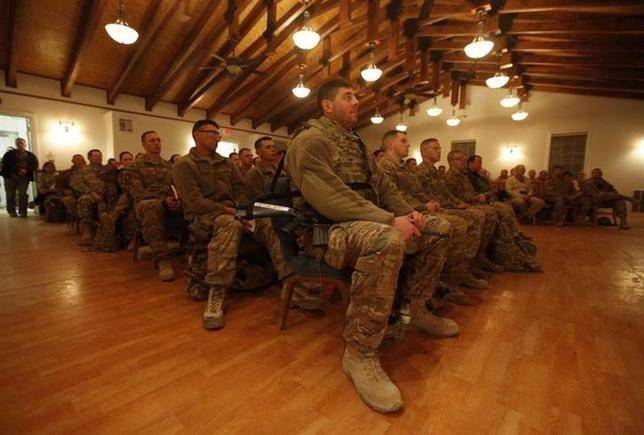 NATO troops from the International Security Assistance Force (ISAF) attend a Christmas eve mass at Bagram Airfield, north of Kabul, early December 25, 2013. REUTERS/Mohammad Ismail