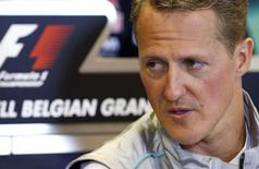 Mercedes Formula One driver Michael Schumacher of Germany addresses a news conference ahead of the weekend's Belgian F1 Grand Prix in Spa Francorchamps August 30, 2012. REUTERS/Francois Lenoir