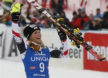 Austria's Marlies Schild celebrates after winning the women's giant slalom World Cup race in the Tyrolean ski resort of Lienz December 29, 2013. REUTERS/Leonhard Foeger