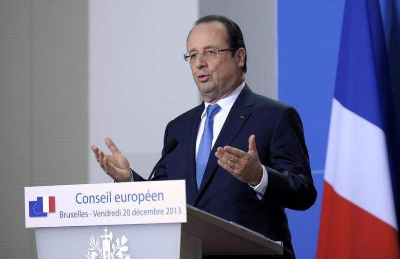 France's President Francois Hollande addresses a news conference during a European Union leaders summit in Brussels December 20, 2013. REUTERS/Laurent Dubrule