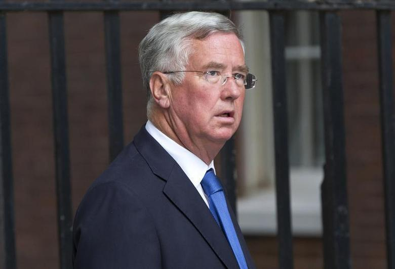Conservative MP Michael Fallon arrives at Downing Street in London, September 4, 2012. REUTERS/Neil Hall