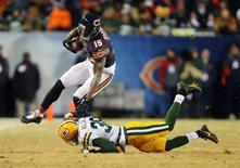 Dec 29, 2013; Chicago, IL, USA; Chicago Bears wide receiver Brandon Marshall (15) is tackled by Green Bay Packers cornerback Tramon Williams (38) during the second half at Soldier Field. Green Bay won 33-28. Mandatory Credit: Dennis Wierzbicki-USA TODAY Sports