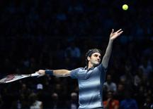 Roger Federer of Switzerland serves to Rafael Nadal of Spain during their men's singles semi-final tennis match at the ATP World Tour Finals at the O2 Arena in London November 10, 2013. REUTERS/Dylan Martinez