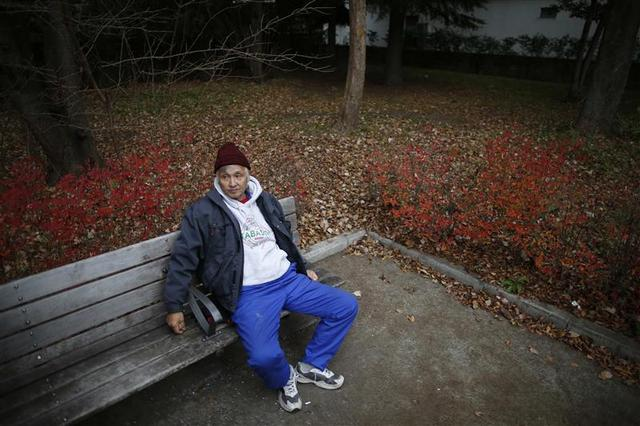 Shizuya Nishiyama, a 57-year-old homeless man from Hokkaido, rests on a bench at a park near Sendai Station in Sendai, northern Japan December 18, 2013. REUTERS/Issei Kato