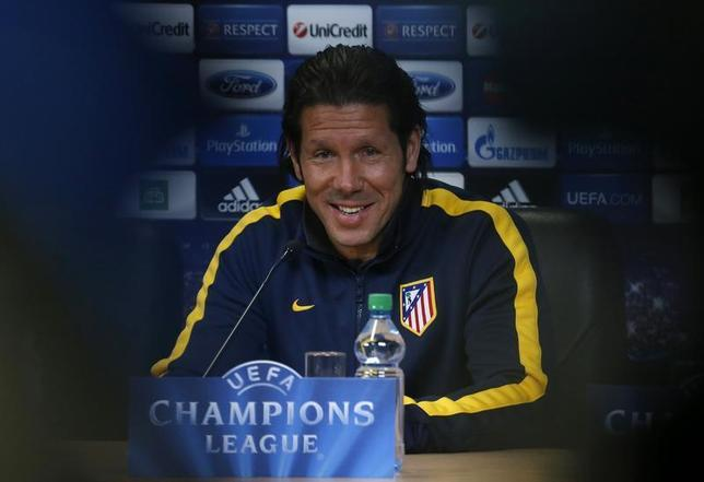 Atletico Madrid coach Diego Simeone attends a news conference before a training session at Petrovsky stadium in St.Petersburg November 25, 2013. REUTERS/Alexander Demianchuk