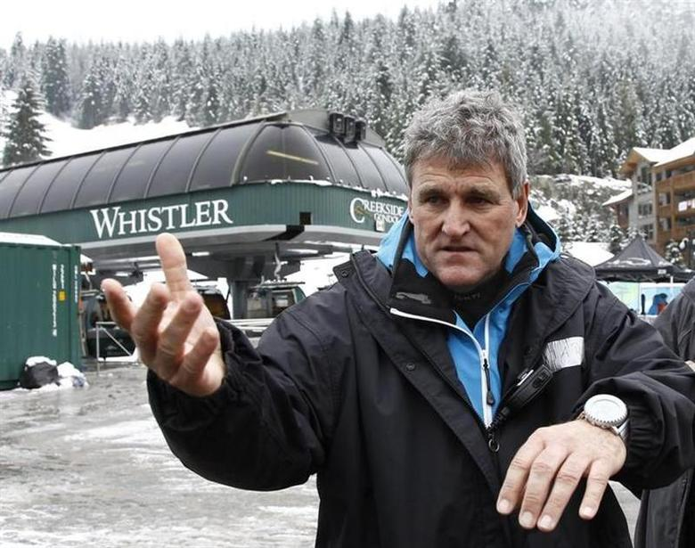 FIS race director Guenter Hujara talks to reporters in Whistler after the men's Alpine Skiing Super Combined event was postponed due to weather at the Vancouver 2010 Winter Olympics in Whistler, British Columbia, February 16, 2010. REUTERS/Leonhard Foeger