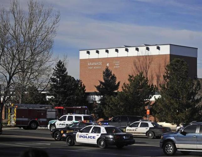 Police and rescue workers arrive at Arapahoe High School, after a student opened fire in the school in Centennial, Colorado December 13, 2013. REUTERS/Evan Semon