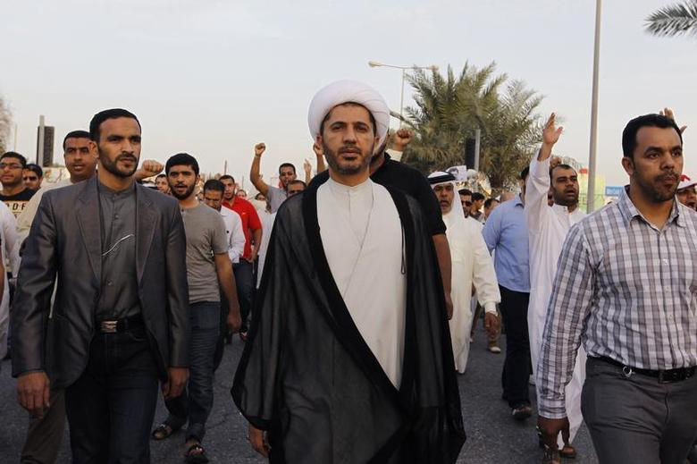 General Secretary of Al-Wefaq, Ali Salman (C), walks as protesters behind him shout anti-government slogans during a rally organized by Bahrain's main opposition party Al Wefaq in Budaiya, west of Manama, December 13, 2013. REUTERS/Hamad I Mohammed