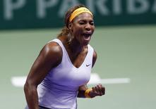 Serena Williams of the U.S. reacts during her WTA tennis championships final match against Li Na of China at Sinan Erdem Dome in Istanbul, October 27, 2013. REUTERS/Murad Sezer