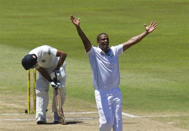 South Africa's Vernon Philander celebrates the wicket of India's Rohit Sharma during the fifth day of the second test cricket match in Durban, December 30, 2013. REUTERS/Rogan Ward