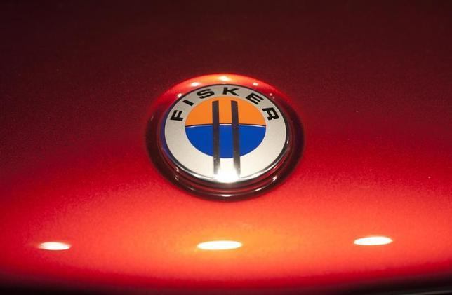 The Fisker automotive electric Atlantic sedan logo is seen during its unveiling ahead of the 2012 International Auto Show in New York April 3, 2012. REUTERS/Allison Joyce