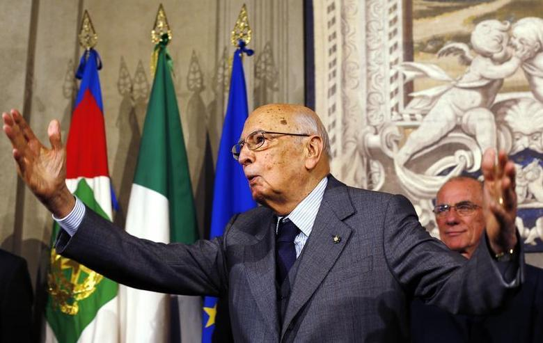 Italian President Giorgio Napolitano gestures after a news conference at the Quirinale Palace in Rome, April 27, 2013. REUTERS/Alessandro Bianchi