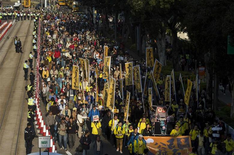 Thousands of pro-democracy protesters march in the streets to demand universal suffrage and urge Hong Kong's Chief Executive Leung Chun-ying to step down in Hong Kong January 1, 2014. REUTERS/Tyrone Siu