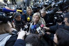 Sabine Kehm (C), agent for seven-times Formula One world champion Michael Schumacher, talks to journalists outside the CHU hospital emergency unit in Grenoble, French Alps, January 1, 2014. REUTERS/Charles Platiau
