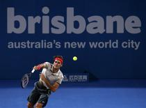 Roger Federer of Switzerland serves against Jarkko Nieminen of Finland during their men's singles match at the Brisbane International tennis tournament in Brisbane, January 1, 2014. REUTERS/Jason Reed