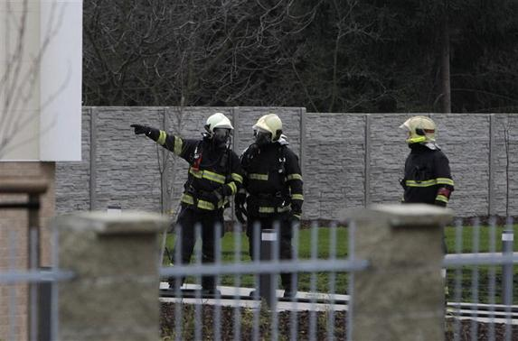 Firefighters search an area after an explosion in Prague January 1, 2014.
