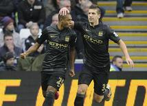 Manchester City's Fernandinho (L) celebrates scoring a goal against Swansea City with Matija Nastasic during their English Premier League soccer match at the Liberty Stadium in Swansea, Wales, January 1, 2014. REUTERS/Rebecca Naden