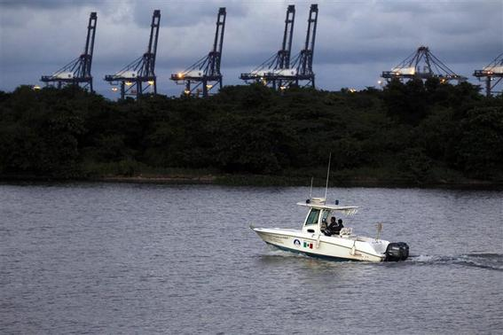 Port security patrol the delta of the River Balsas in the port of Lazaro Cardenas November 20, 2013. REUTERS/Edgard Garrido