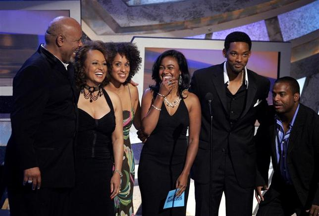 The cast of the television series 'The Fresh Prince of Bel-Air' (L-R) James Avery, Daphne Maxwell Reid, Karyn Parsons, Tatyana Ali, Will Smith and Alfonso Ribeiro reunite at the 2005 BET Awards in Hollywood, California in this file photo taken June 28, 2005. James Avery, a classically trained actor best known for his role as the wealthy uncle of the young rapper Will Smith in the 1990s television comedy ''The Fresh Prince of Bel-Air,'' has died at age 65. REUTERS/Robert Galbraith/Files