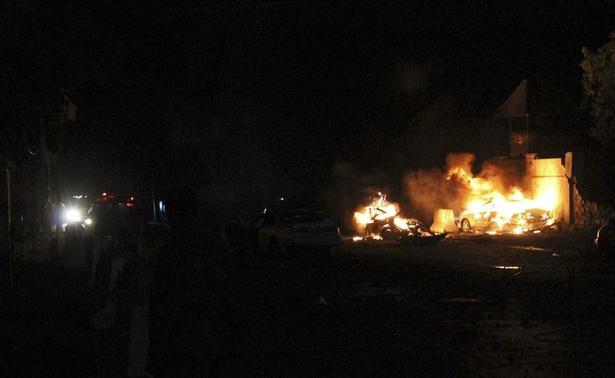 Fire burns at the scene of an explosion outside the Jazira hotel in Mogadishu January 1, 2014. REUTERS-Feisal Omar