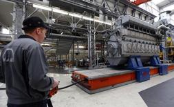 Workers assemble a large Diesel engine at the MAN Diesel & Turbo factory in Augsburg March 6, 2013. REUTERS/Michael Dalder