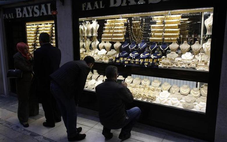 People look at gold jewelleries at a jewellery shop at the Grand Bazaar in Istanbul December 5, 2013. REUTERS/Murad Sezer/Files