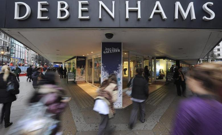 People rush past Debenhams department store on Oxford Street, in central London, January 10th 2011. REUTERS/Ki Price