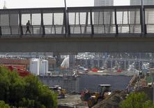 A pedestrian walks over a large construction project for U.S. Customs at the San Ysidro border crossing into the United States in San Ysidro, California, March 1, 2013. REUTERS/Mike Blake