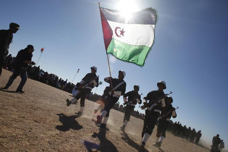 Polisario Front soldiers take part in a parade for the 35th anniversary celebrations of their independence movement for Western Sahara from Morocco, in Tifariti, southwestern Algeria February 27, 2011. REUTERS/Juan Medina