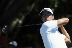 Australia's Adam Scott hits on the tenth hole during the fourth round of the Australian Open golf tournament at Royal Sydney Golf Club December 1, 2013. REUTERS/Steve Christo