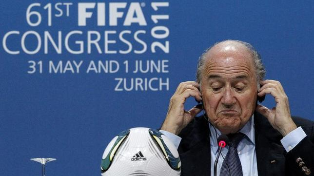 FIFA President Sepp Blatter reacts during a news conference after being re-elected for a fourth term as president of world soccer's governing body during the 61st FIFA congress at the Hallenstadion in Zurich June 1, 2011. REUTERS/Arnd Wiegmann