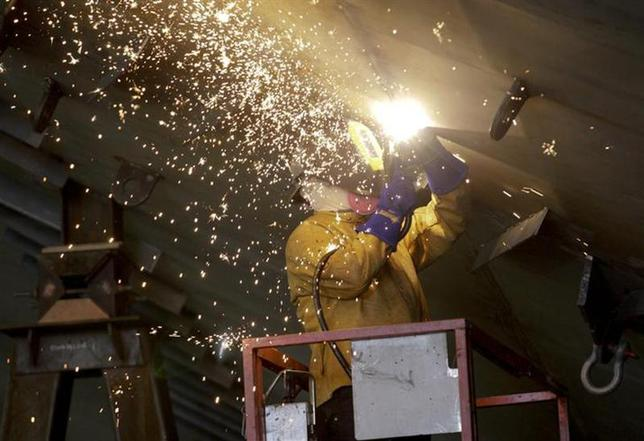 A Vigor Industrial employee welds metal on a ferry being built for Washington State Ferries at the company's Harbor Island centre in Seattle, Washington November 25, 2013. REUTERS/Jason Redmond/Files