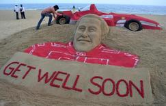 Indian sand artist Sudarshan Pattnaik works on a sand sculpture of seven-times Formula One world champion Michael Schumacher to wish him a speedy recovery at Puri in the eastern Indian state of Odisha January 2, 2014. REUTERS/Stringer