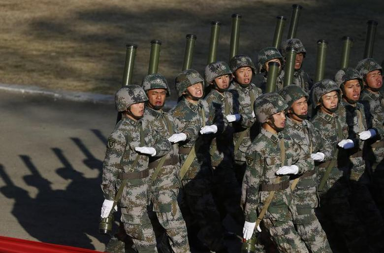 Soldiers of the Chinese People's Liberation Army march during their drill ahead of their year-end review in Jiaxing, Zhejiang province, November 29, 2013. REUTERS/William Hong