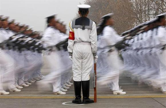 Chinese People's Liberation Army Navy recruits march during a parade to mark the end of a semester at a military base of the North Sea Fleet, in Qingdao, Shandong province December 5, 2013. REUTERS/China Daily/Files